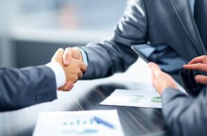 people shaking hands during hotel lending meeting